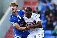 Donervon Daniels of Wigan Athletic and Cameron Burgess of Oldham Athletic tussle in the area during the EFL Cup match between Oldham Athletic and Wigan Athletic at Boundary Park, Oldham, England on 9 August 2016. Photo by Simon Brady.