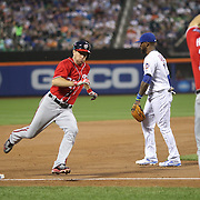 NEW YORK, NEW YORK - July 09: Pitcher Max Scherzer #31 of the Washington Nationals is waved home while rounding third base on a Ben Revere #9 of the Washington Nationals triple during the Washington Nationals Vs New York Mets regular season MLB game at Citi Field on July 09, 2016 in New York City. (Photo by Tim Clayton/Corbis via Getty Images)