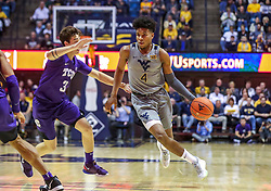 Jan 14, 2020; Morgantown, West Virginia, USA; West Virginia Mountaineers guard Miles McBride (4) drives past TCU Horned Frogs guard Francisco Farabello (3) during the second half at WVU Coliseum. Mandatory Credit: Ben Queen-USA TODAY Sports