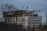 Seen from Ruskin Park in Lambeth south London, the Agusta-Westland AW-169 helicopter G-KSSC of the Kent Air Ambulance lifts off from the helipad of Kings College Hospital in Camberwell, on 11th February 2019, in London, England.