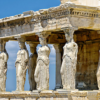 Acropolis. Athens. Greece. View of the famous Caryatid porch on the south side of the Erechtheion on the Acropolis summit. The porch or balcony has six sculptured graceful figures of maidens supporting the entablature.