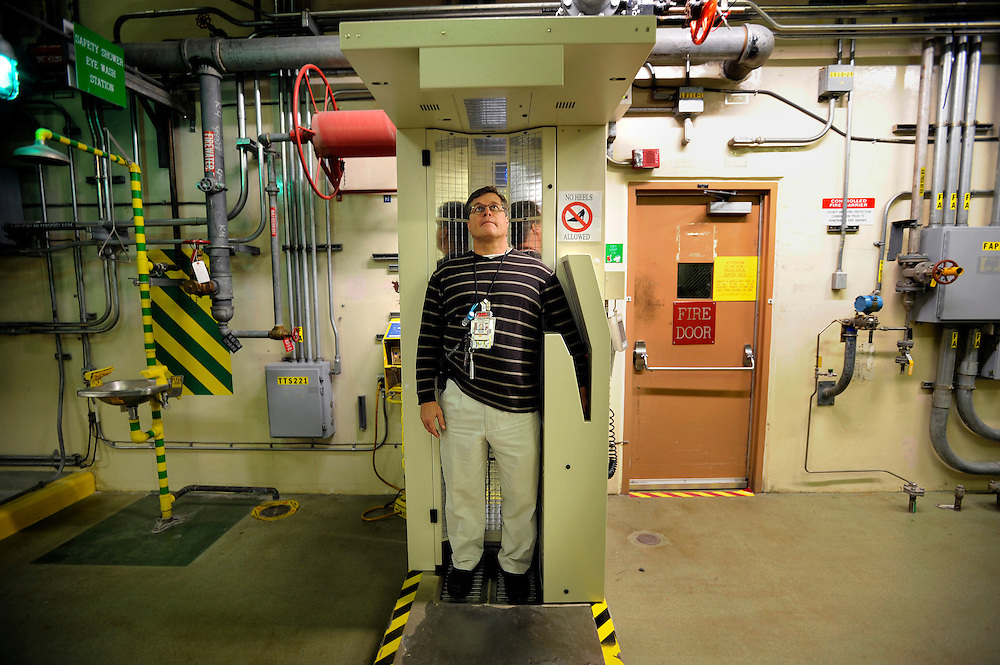 AIKEN, S.C. - NOVEMBER, 20 2013: Shift manager Michael Novak checks himself for contamination in a radiological detector before leaving the clean work area in the Defense Waste Processing Facility at the old Savannah River Site nuclear weapons plant near Aiken, S.C. The Energy Department began to cure an environmental nightmare at the site in 1996 by opening a factory to turn liquid radioactive wastes into a safer form. CREDIT: Stephen Morton for The New York Times