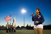 Senior Lea Acuna performs the Star Spangled Banner with the Milpitas NJROTC Color Guard in the background before the Homecoming game against Saratoga at Milpitas High School in Milpitas, California, on October 10, 2014. Milpitas beat Saratoga 49-0. (Stan Olszewski/SOSKIphoto)