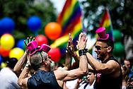 Men celebrate, as they attend the annual Gay Pride parade in London, Britain, 29 June 2013. BOGDAN MARAN / BPA