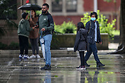 People walk following a torrential rain downpoured in Britain's capital near Westminster Palace, Houses of Parliament on Sunday, Aug 8, 2021. Some say that London weather can be one of two things: abjectly miserable or incomparably wonderful. There is no in-between. (VX Photo/ Vudi Xhymshiti)