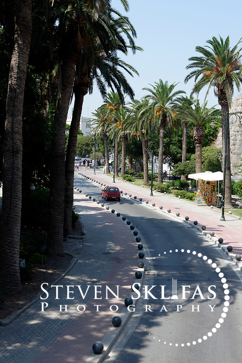 Kos Town. View of a section of Palm Tree Avenue. The Avenue was once the castle moat. Kos is part of the Dodecanese island group and birthplace of the ancient physician and father of medicine, Hippocrates.