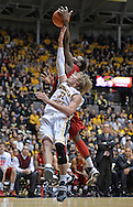 WICHITA, KS - NOVEMBER 12:  Guard Ron Baker #31 of the Wichita State Shockers goes up for a rebound against guard T.J. Price #52 of the Western Kentucky Hilltoppers during the second half on November 12, 2013 at Charles Koch Arena in Wichita, Kansas.  (Photo by Peter Aiken/Getty Images) *** Local Caption *** Ron Baker;T.J. Price