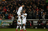 Jordan Ayew of Swansea city ® celebrates with his teammates after he scores his teams 1st goal to make it 1-1.  Premier league match, Swansea city v Crystal Palace at the Liberty Stadium in Swansea, South Wales on Saturday 23rd December 2017.<br /> pic by  Andrew Orchard, Andrew Orchard sports photography.