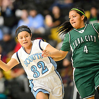1212713  Adron Gardner/Independent<br /> <br /> Window Rock Scout Naomi Klah (32), left, drives by Tuba City Warrior Samytha Parrish (4) in Chinle Friday.