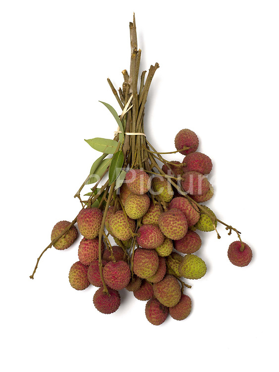 A bunch of lychees grown in the Tai Dam ethnic minority village of Ban Na Mor, Oudomxay province, Lao PDR. The women of Ban Na Mor sell seasonal local products in their roadside market which they have gathered from the fields and forests or grown in their own gardens – anything from cucumbers to bamboo rats, pineapples to barbequed frogs. Ban Na Mor market is ideally situated on route 13 which goes to the border with China allowing them to take advantage of. the many Chinese tour buses and businessmen passing through