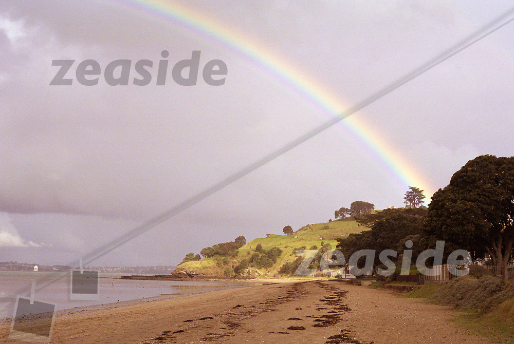 A rainbow spanning North Head and Cheltenham Beach in late afternoon.