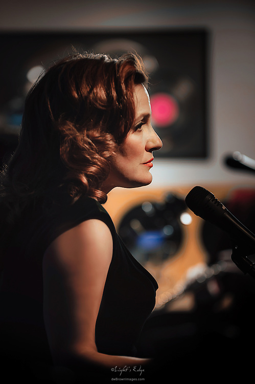Michele Peraino, lead vocals for Swing That Cat, during their performance in the first live music event at Human Village Brewing Co.