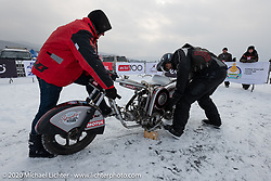 Sergey Batyrin on his Ural modified to be in-line with a snowmobile transmission and pull-start in the Baikal Mile Ice Speed Festival. Maksimiha, Siberia, Russia. Thursday, February 27, 2020. Photography ©2020 Michael Lichter.