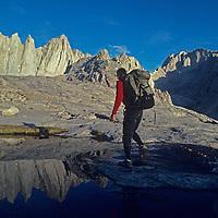 A hiker walks past a tarn below Mount Whitney in the John Muir Wilderness of California's Sierra Nevada.