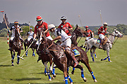 Nikolina Gora, Moscow Region, Russia, 25/06/2005..The Russky Standart Imperia Vodka team [red strip] playing at the Russian Polo Cup 2005, organised by the Russian Federation of Polo Players.