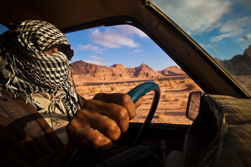 Bedouin guide Etzal Salem drives across the desert in a jeep in Wadi Rum, Jordan.