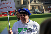 People's Vote supporters wearing blindfolds and carrying placards assembled in Parliament Square for the Blindfold Brexit protest ahead of a crunch debate in the House of Commons to illustrate that this Brexit would provide no clarity and no closure about our future relationship with Europe on 14th February 2019 in London, England, United Kingdom. Anger boils over with one protester.