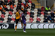 Newport County's Mickey Demetriou (28) heads clear during the EFL Sky Bet League 2 match between Newport County and Tranmere Rovers at Rodney Parade, Newport, Wales on 17 October 2020.