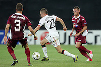 Ivo Pinto (L) and Viorel Nicoara (D) of CFR Cluj challenges Tom Cleverley (C) of Manchester United during the UEFA Champions League, Group H, soccer match at Dr. Constantin Radulescu Stadium in Cluj-Napoca, Romania, 2 October 2012.