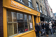 The Breakfast Club restaurant in Soho, London, England, United Kingdom. The Breakfast Club is incredibly popular amongst young people who are seen queueing outside at each of the sites of this trendy cafe, although they insist this should be known as a caf.
