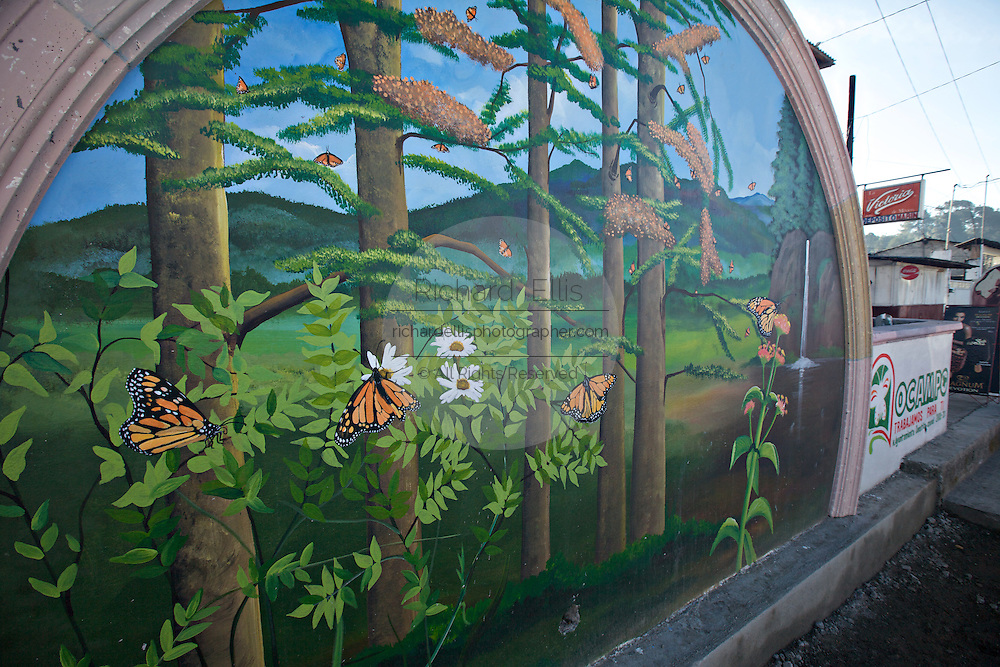 A Monarch Butterfly mural in the tiny central Mexican town of Ocampo in Michoacan, Mexico at the Monarch Butterfly Biosphere Reserve. Each year hundreds of millions Monarch butterflies mass migrate from the U.S. and Canada to Oyamel fir forests in the volcanic highlands of central Mexico. North American monarchs are the only butterflies that make such a massive journey—up to 3,000 miles (4,828 kilometers).