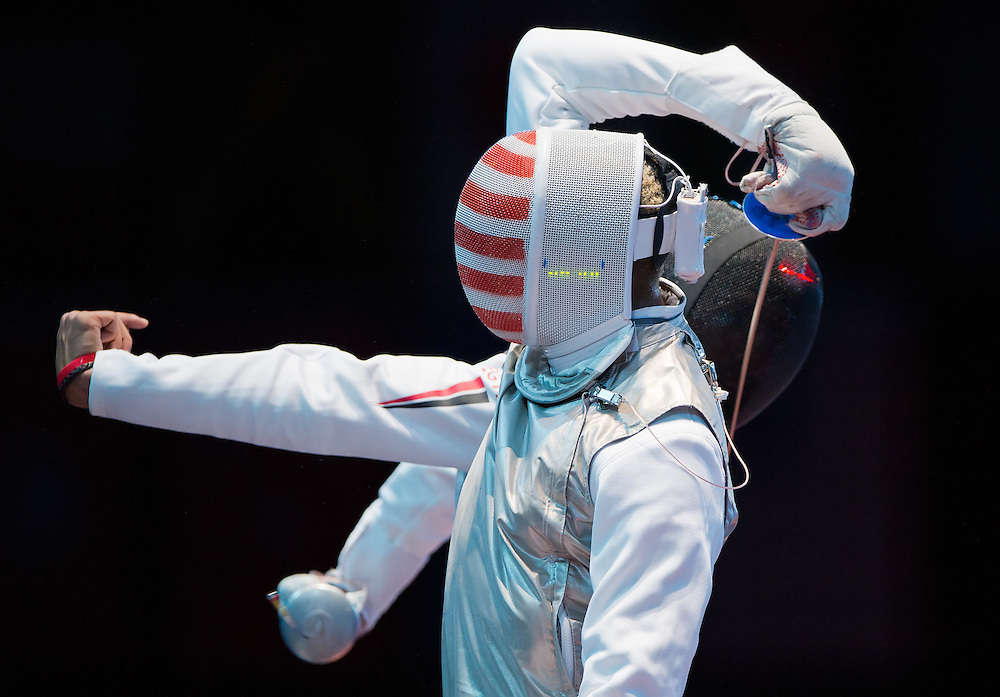 Miles Chamley-Watson of the United States got tangled up with Egypt's Alaaeldin Abouelkassem in the round of 32 in the men's foil individual competition at the ExCel centre during the 2012 Summer Olympic Games in London, England, Tuesday, July 31, 2012. (David Eulitt/Kansas City Star/MCT)