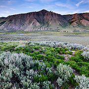 The sun sets over a valley in the Upper Gros Ventre range near Grand Teton National Park, Wyoming.