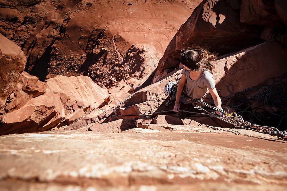 Julia Geisler climbs the final pitch of Kor Ingalls, 5.10, Castle Valley, Utah.