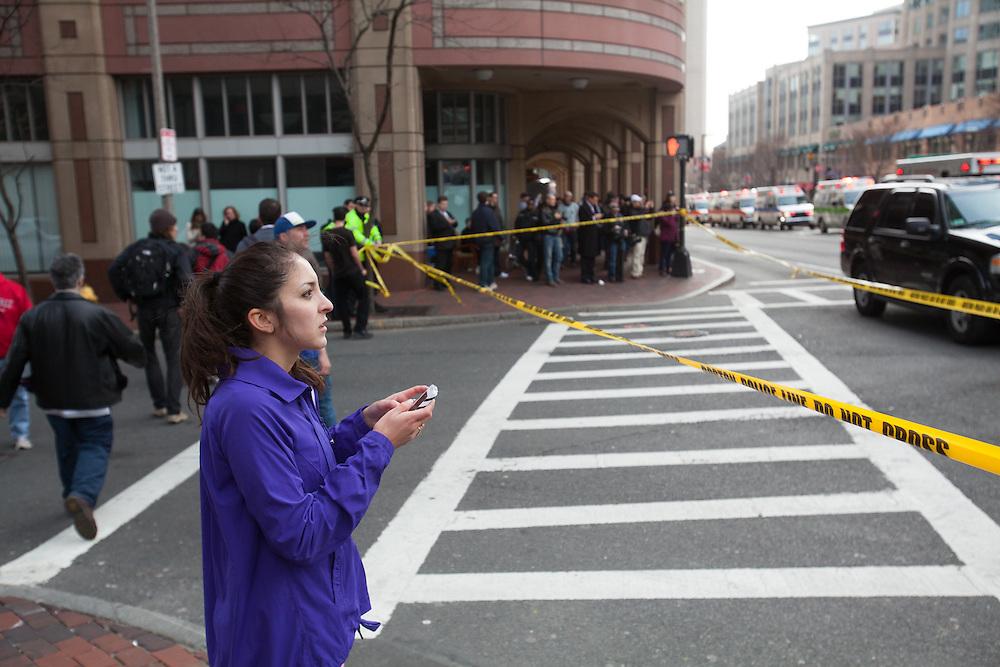 Boston, MA 04/15/2013.A spectator looks across Huntington Ave. after two explosions at the end of the Boston Marathon on Monday..Alex Jones / www.alexjonesphoto.com