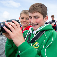 Jack and Luke Fitzgerald photographing the start of the swim at the Annual Pat Conway and friends Charity Swim from Lahinch to Liscannor Pier in aid of the Burren Chernobyl Project