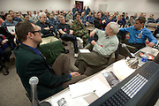 WHNPA members provide feedback to an on hand audience during the Military Photographer of the Year judging as Chip Somodevilla, Bruce Dale and Jim Dietz go through hundreds of images at Defense Information School, Fort Meade, Maryland..  Photo by Johnny Bivera