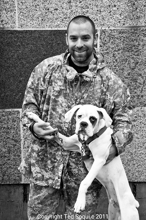 Portraits of people at Occupy LA in downtown Los Angeles..Sam Grey and his dog Pistol Pete, civilian defence contractor, from Oceanside, CA..