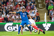 (9) Harry Kane, Slovakia (22) Stanislav LOBOTKA during the FIFA World Cup Qualifier match between England and Slovakia at Wembley Stadium, London, England on 4 September 2017. Photo by Sebastian Frej.