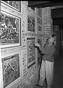 """Pauline Bewick Art Exhibition..1986..03.06.1986..06.03.1986..3rd June 1986..At the Guinness Hop Store,Dublin,artist Pauline Bewick is having an exhibition of her work.The exhibition called """"2 to 50 years""""is a display of her work from age 2 to the present.the art work ranges from simple pencil sketches to more complex paintings and lino cuts...Picture shows the artist,Pauline Bewick,with a selection of her lino cuts which she has on display on the walls of The Hop Store."""