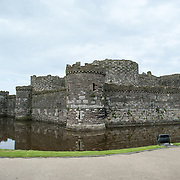 The walls of Beaumaris Castle on the island of Anglesey of the north coast of Wales, UK. The castle dates back to the 13th century and is one of several commissioned by Edward I.