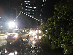 April 17, 2018 - Kolkata, West Bengal, India - Eight people were killed and several others injured on Tuesday after strong winds of up to 98 km per hour hit the West Bengal capital and its adjoining areas, disrupting public transport and traffic, officials said...Unconfirmed sources, however, put the death toll at 13.....Five deaths were reported here while two died in Bankura district and one in Howrah district, police said. Three died in Belur and one in Dumurjola of Howrah district, state police control room officials told.One person died after being struck by lighting in Indus of Bankura district. Electrocution claimed one life in Hooghly district.....The twin storms played havoc with the public transport system, as trams and trains halted on their tracks with the overhead wires snapping. Flight services were affected for 100 minutes. The Kolkata Metro Railway services were hit when a tree fell between Dum Dum and Noapara stations, as passengers got stuck in the tunnel. Suburban train services of South Eastern Railway and Eastern Railway went haywire as trains were stopped at various stations. In South Eastern Railway's Howrah division, services were disrupted in Howrah-Bardhaman and Howrah-Tarakdewhar sections, badly inconveniencing thousands of passengers. In Eastern Railway's Sealdah division, train movement was disrupted in various sections.On April 17,2018 in Kolkata,India. (Credit Image: © Debajyoti Chakraborty/NurPhoto via ZUMA Press)