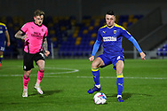 AFC Wimbledon midfielder Anthony Hartigan (8) passing the ball during the EFL Sky Bet League 1 match between AFC Wimbledon and Peterborough United at Plough Lane, London, United Kingdom on 2 December 2020.