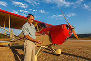 Mathew Northway demonstrating how the fuel gauge on his Interstate Cadet, NC37369, at Creswell Airport.