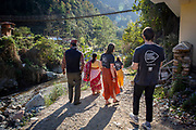 Some of the Bukhel group of volunteers heading through the community back to their host home  Bukhel, Nepal.  ICS / Restless Development volunteers in the Dakshinkali region of Nepal. (© Andy Aitchison / ICS)
