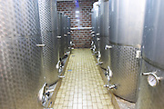 The winery with stainless steel fermentation and storage tanks. Vinarija Stankela Stanko winery, Medugorje, near Mostar. Medjugorje. Federation Bosne i Hercegovine. Bosnia Herzegovina, Europe.