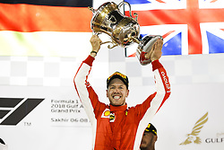 April 8, 2018 - Sakhir, Bahrain - VETTEL Sebastian (ger), Scuderia Ferrari SF71H, celebrating his victory on the podium during 2018 Formula 1 FIA world championship, Bahrain Grand Prix, (Credit Image: © Hoch Zwei via ZUMA Wire)