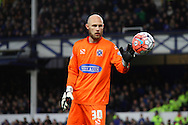 Dagenham & Redbridge goalkeeper Mark Cousins in action. The Emirates FA cup, 3rd round match, Everton v Dagenham & Redbridge at Goodison Park in Liverpool on Saturday 9th January 2016.<br /> pic by Chris Stading, Andrew Orchard sports photography.