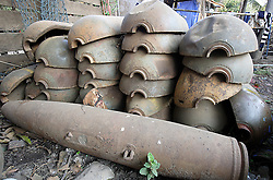 CBUs (Cluster Bomb Units) used to contain hundreds of anti personnel devices, also commonly known as a Bombies. They now sit in piles of scrap metal collected for resale. This has caused many problems and accidents throughout Laos.  Huge stockpiles of collected scrap often contain live and very dangerous items of UXO (Unexploded Ordnance)  near Sekong, Lao PDR