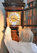"©London News pictures...28/10/2010.  Dudley Taylor (76) a clock maker all his life, changes the time on a Marquetre clock dated cira 1700. Staff at Horological Workshops start the task of changing the 100's of clocks at their store in Guildford, Surrey, UK. Micahel Tooke who has owned the store for 43 years and worked in the clock business all his life said. ""at this time of year we get alot of people who bring clocks in for repair after they have changed the time incorreectly by winding back the hands manually"""