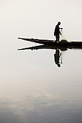 A man fishes on the Niger River early in the morning in Bamako, Mali