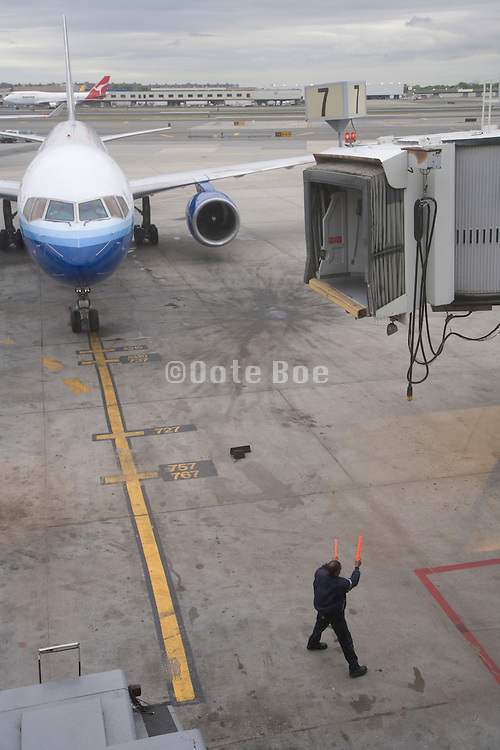 airplane being taxied to the gate