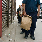 Undocumented immigrants are returned to Mexico after being detained in San Diego, California on January 20th, 2009. Forty seven migrants were apprehended during the morning hours of inauguration day and deported to Mexico with only their belongings in paper bags. Please contact Todd Bigelow directly with your licensing requests.