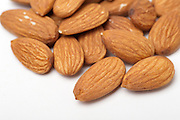 Peeled Almonds in shell On white Background