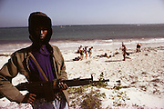 Foreign aid workers (NGO's) on their day off go to the beach with armed guards.  Mogadishu, war-torn capital of Somalia. (1992).