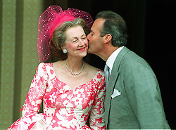 """Library file 256358-21a, dated 10.07.93, of the Count de Chambrun kissing his new bride the Dowager Countess Raine Spencer, the ex-stepmother of Diana, Princess of Wales,  following the blessing of their marriage. It has been reported that that the couple have divorced quietly at a court in Grasse, sothern France. Raine, 67, described the alleged separation as """"very amicable"""". See PA Story SOCIAL Raine/By Martin Hayhow/PA."""